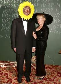 Bette Midler shows cleavage in witch's gown for her